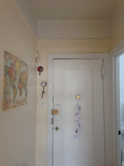 Front door and hallway featuring an Old World-style map.
