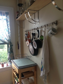 Kitchen details featuring exposed dishes, pots and pans