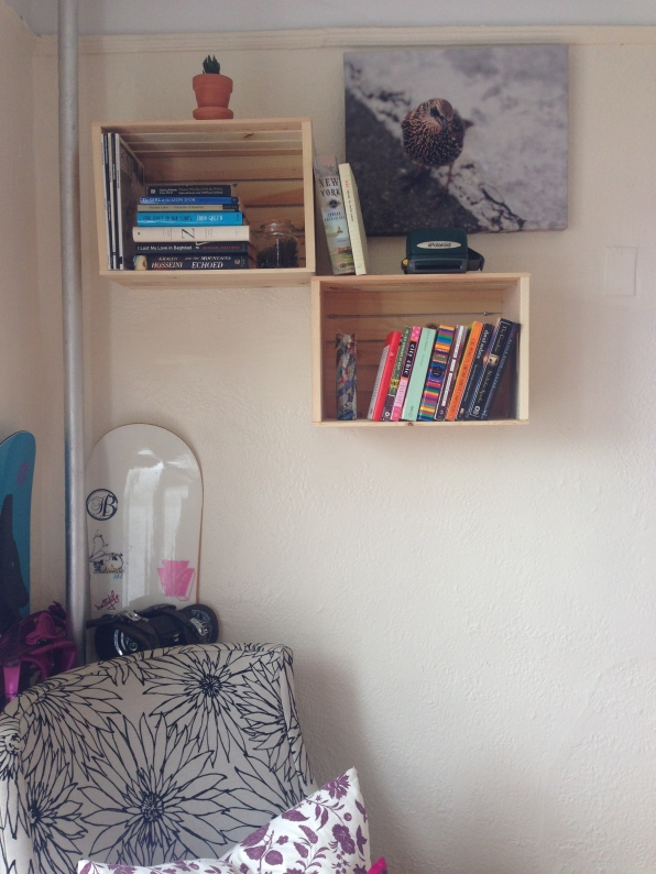 $13 wooden crates from Michael's hung up as storage shelves